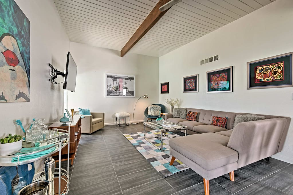 Beat the heat under the living room's exposed beam ceilings.