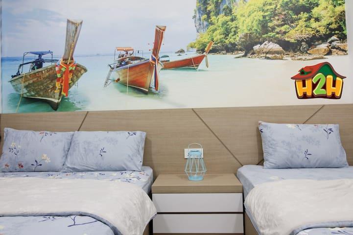 Room 2 - Queen side bed & Singer bed