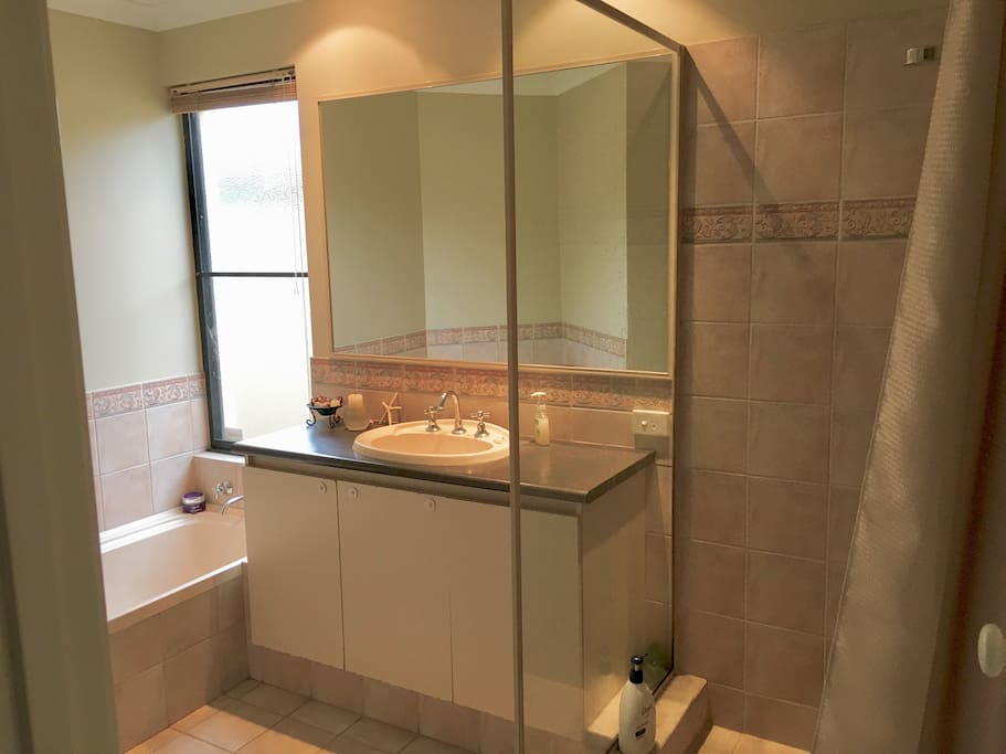 Private bathroom with shower, bath and vanity unit [and separate toilet]