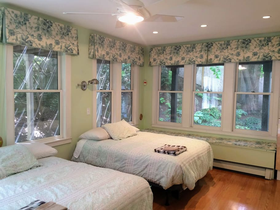 Master bedroom - 2 double beds, blackout shades under the valances