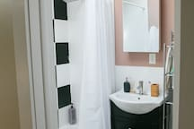 Bright and clean bathroom with full soak in tub