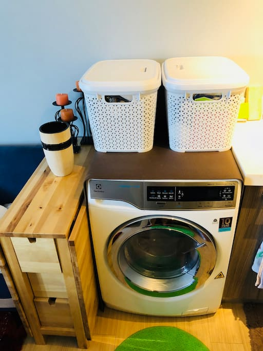 Washer and Dryer machine side by side with extendable table that can seat 4 people.