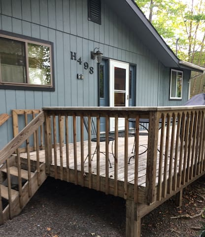 Large gated wraparound deck with patio furniture