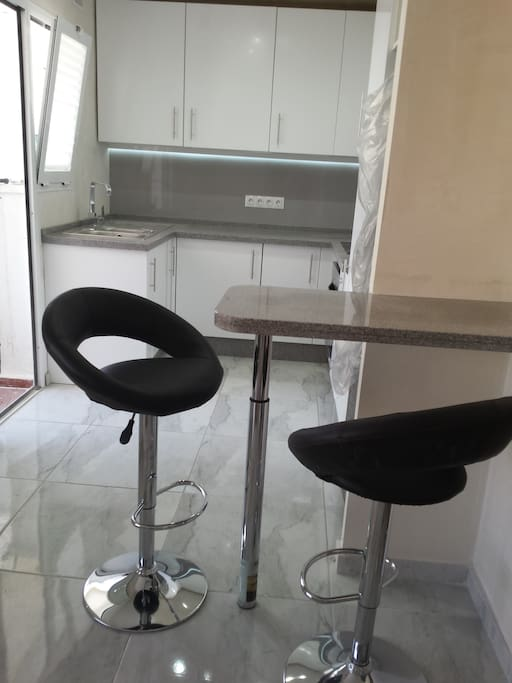 Fully fitted modern kitchen with breakfast bar area.