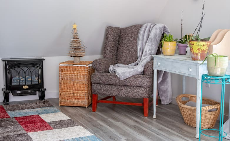 Cozy corner to chill in with a glass of wine.
