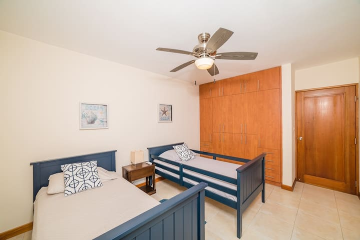 Bedroom with 2 twin beds and optional rollaway bed, private patio