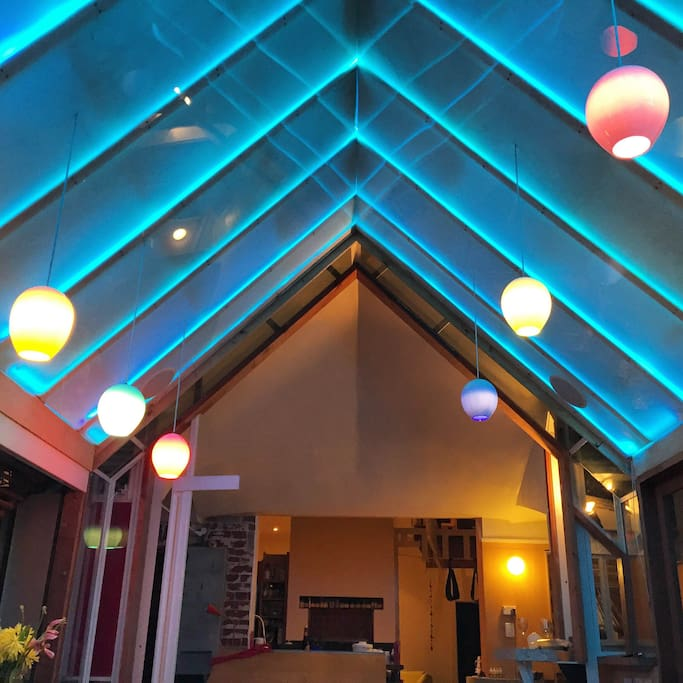 Dining room ceiling glows in every colour.