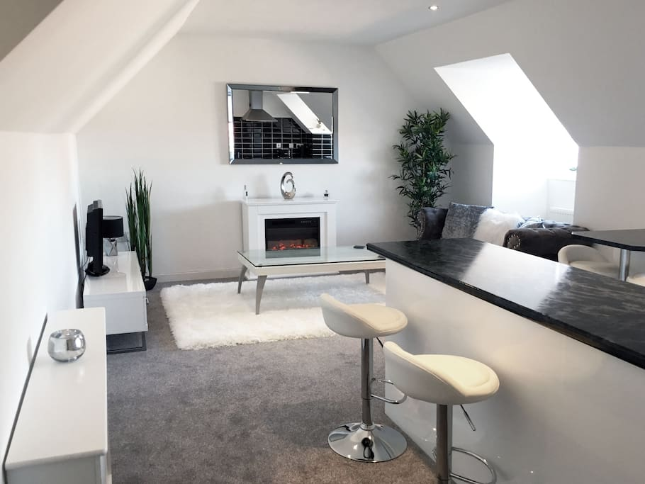 Contemporary living area with a cosy fireplace and freeview TV