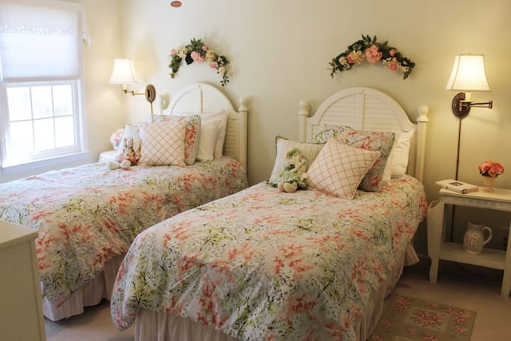 """""""In the Limelight"""" room with two XL twin beds (view to front yard)."""