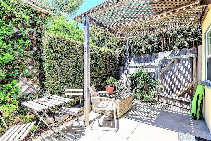 Fully private back patio garden with pergola