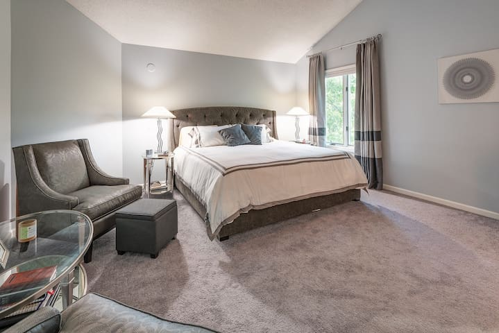 Luxurious and grand Master Bedroom with original and stunning artwork, TV, king bed and sumptuous chairs.  En-suite, two sinked master bath with walk in closet.  PLEASE close drapes by grabbing them up high so as not to dislodge curtain rings.