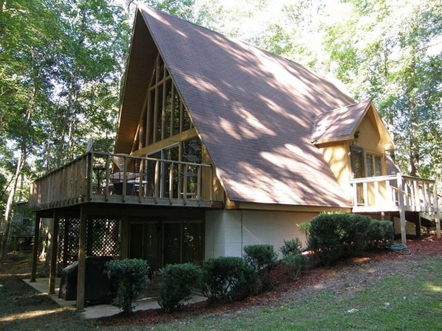 Unusually large for a midcentury a-frame, our home offers 3 floors of living & leisure space nestled on a 1-acre wooded lot.