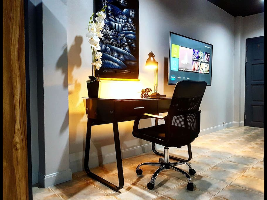 Work desk space with lamp and power outlets.