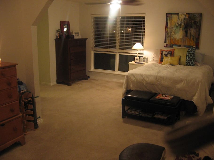 Master Bedroom with California Queen bed, private bath and large enough to add an air mattress or crib.