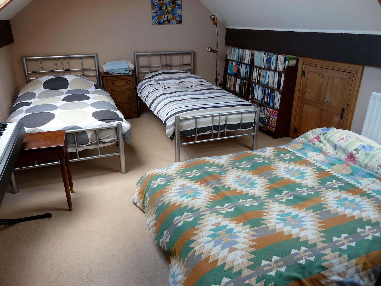 The loft room with two single beds and a futon