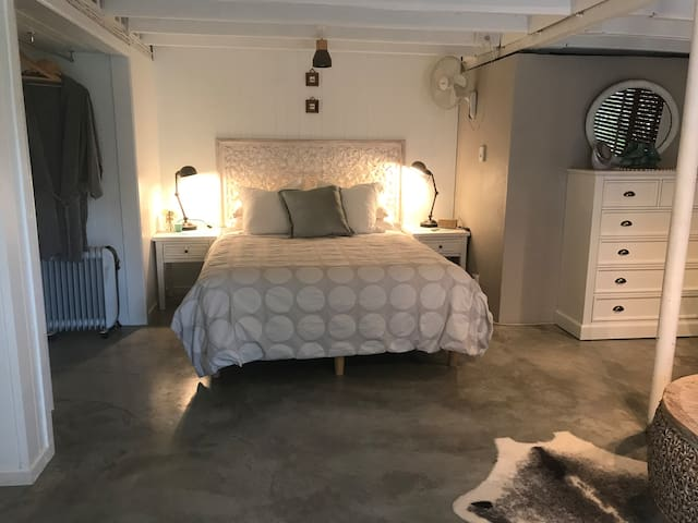 Queen sized bed, aircon or fan, and robes to relax in