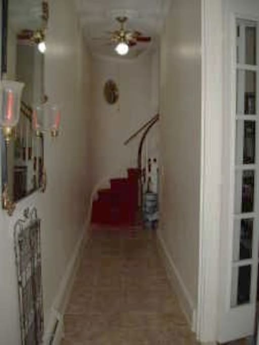The house has an elegant winding staircase to this private 2nd floor apartment with high ceilings.