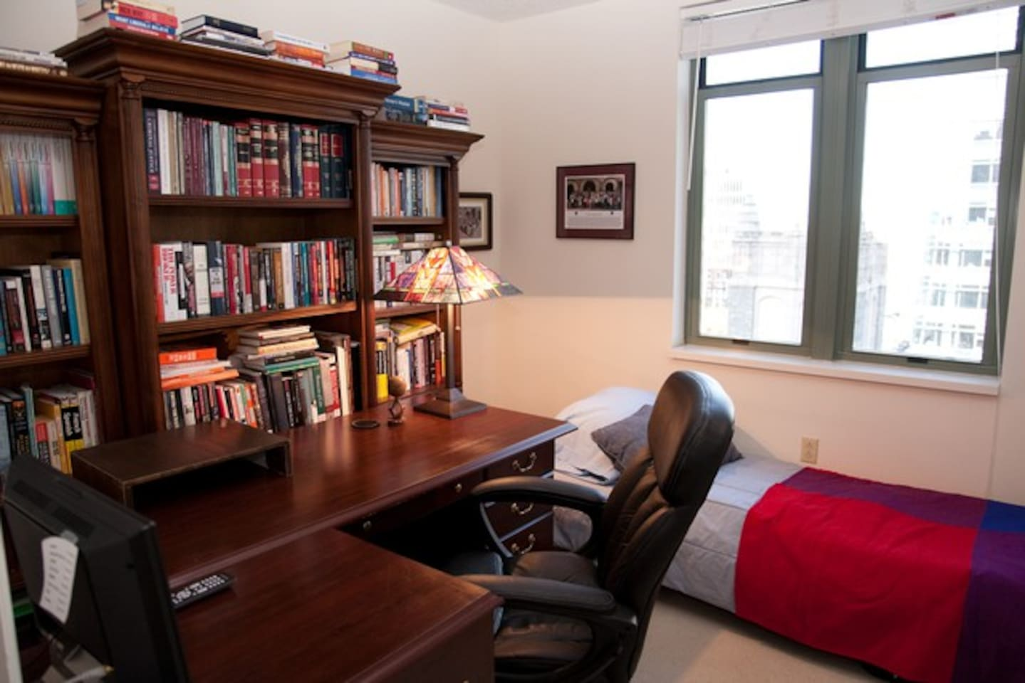 Your room: TV, desk, bed, window, view.