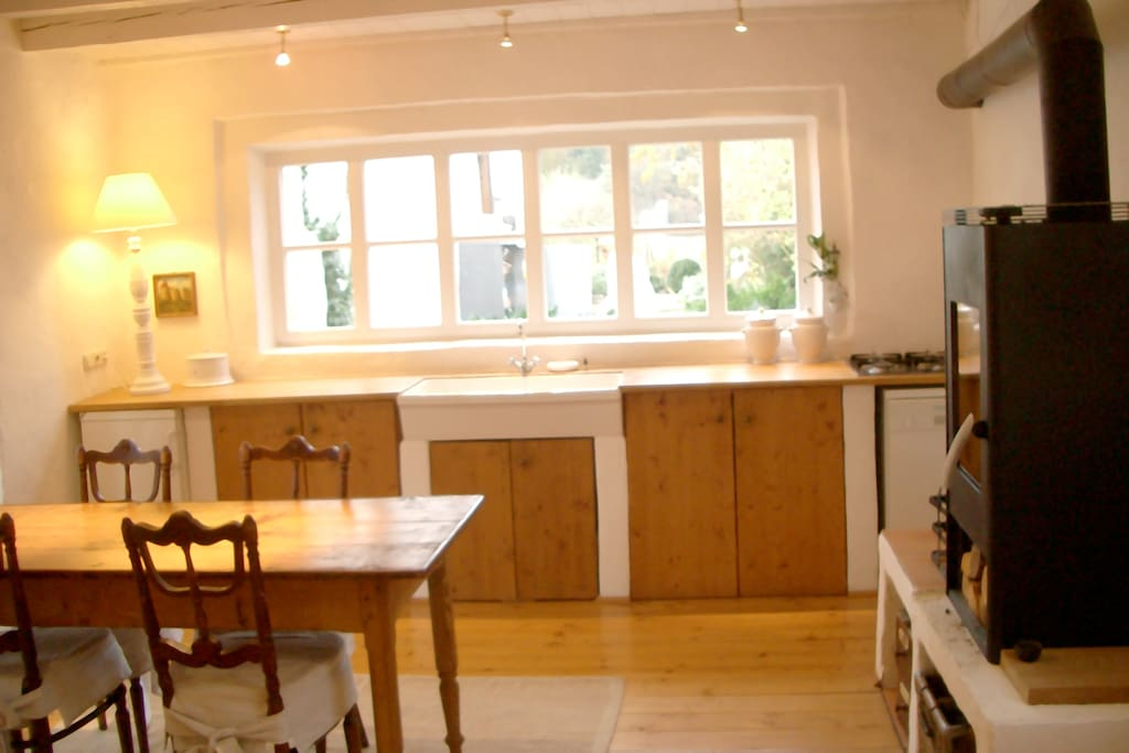 KITCHEN WITH DINING TABLE AND OPEN FIRE PLACE