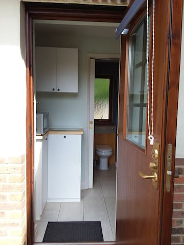External Door through to kitchenette, shower room and bedroom.