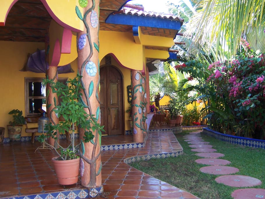 Garden Casita's front entrance with its private patio on the right set amidst a lush tropical garden.  The beach is located directly in front of the terrace.