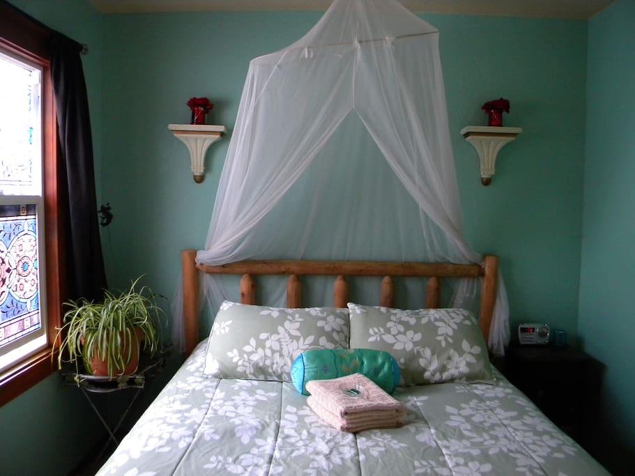 Sleep comfortably in a cozy queen bed.