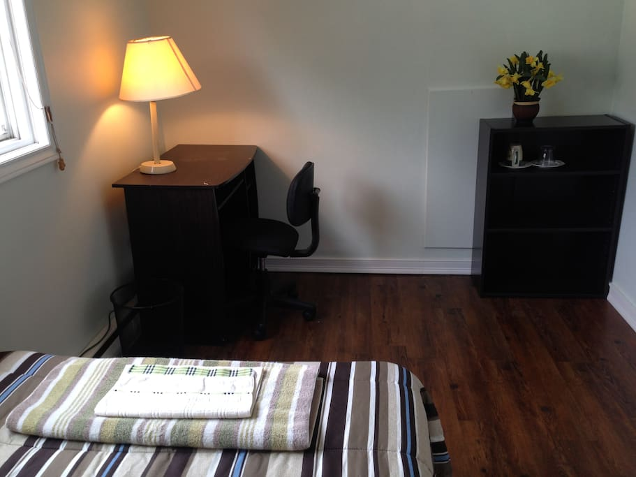 Desk, chair and shelf in the bedroom