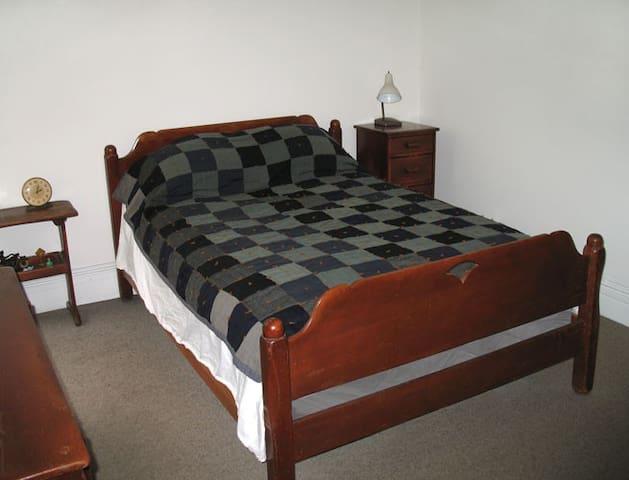 Comfortable full size bed sleeps two.