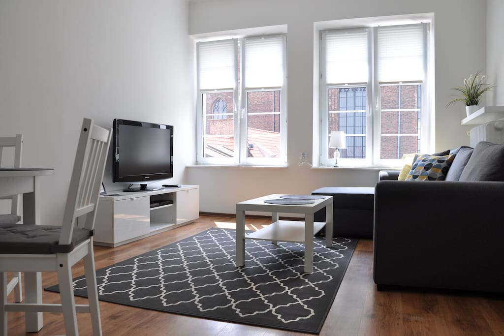 living room with roller blind
