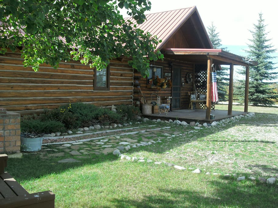 Front porch with handmade Montana furniture to sit and watch the birds and wildlife!  Brick bbq on left side.