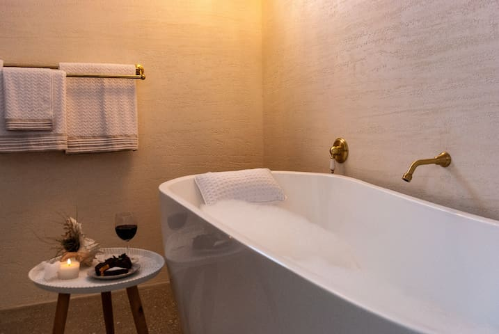 Why not pour yourself a glass of wine and relax in our free-standing bath.