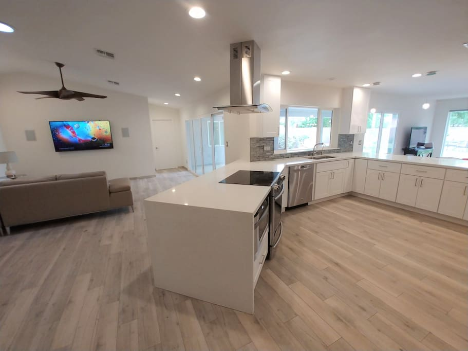 Open floor plan with spacious kitchen and natural light throughout