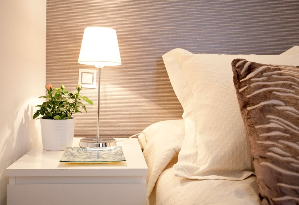 Dark grey Belgian wallpaper decor with reading lamp