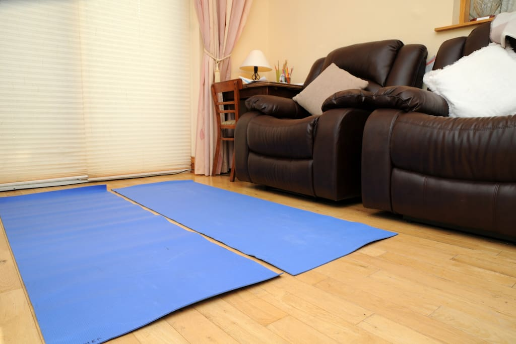 yoga mats to practise yoga meditation or exercise in the bright warm front room