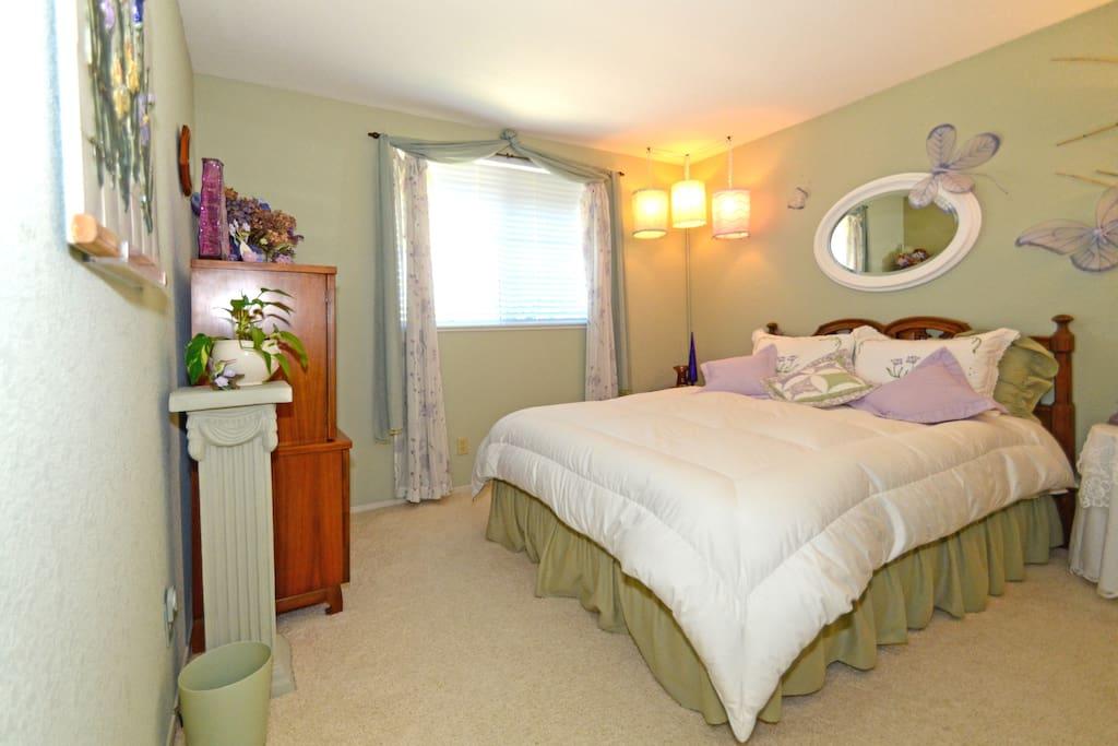 This bedroom has a Queen bed