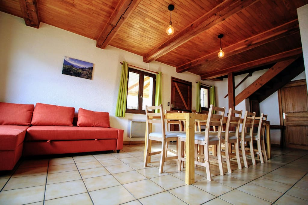 Spacious, cosy living room, with comfortable sofabed and big, handmade wooden table for 11 persons