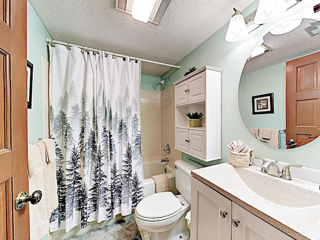 Right outside the 2nd bedroom is a guest bathroom with a tub/shower combination.