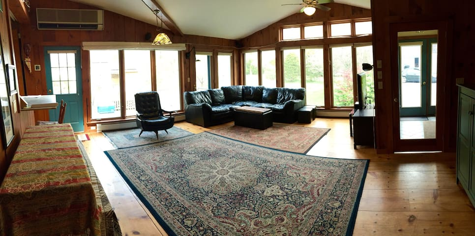 Main family room with ample views from wraparound windows