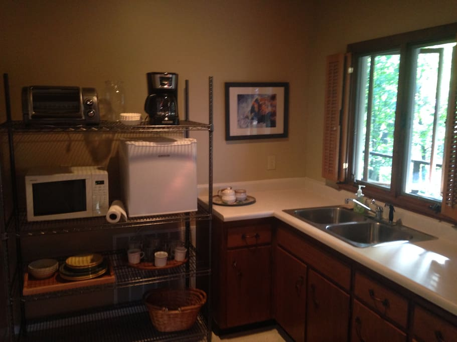 The kitchen features a microwave, coffee maker, mini-fridge, and small oven.  We also provide utensils and dishes.