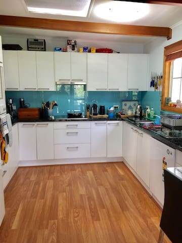 Delightfully refurbished kitchen leads to a covered outdoor patio. Basics for short stays are supplied.