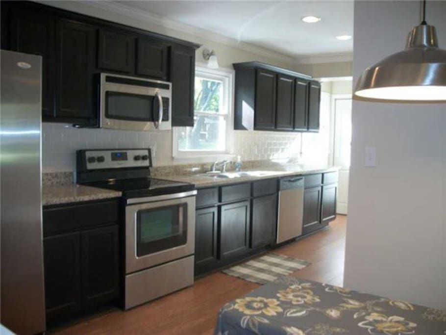 Kitchen includes refrigerator, oven, stove, microwave, blender (margaritas!), coffee maker, and dishwasher.