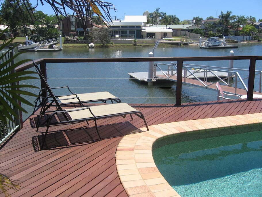 Outdoor entertainment area with a beautiful canal view.