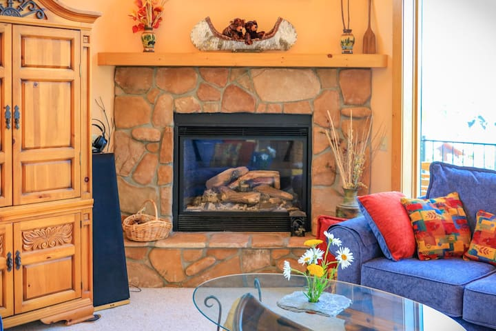 Gas log fireplace with remote control and fan