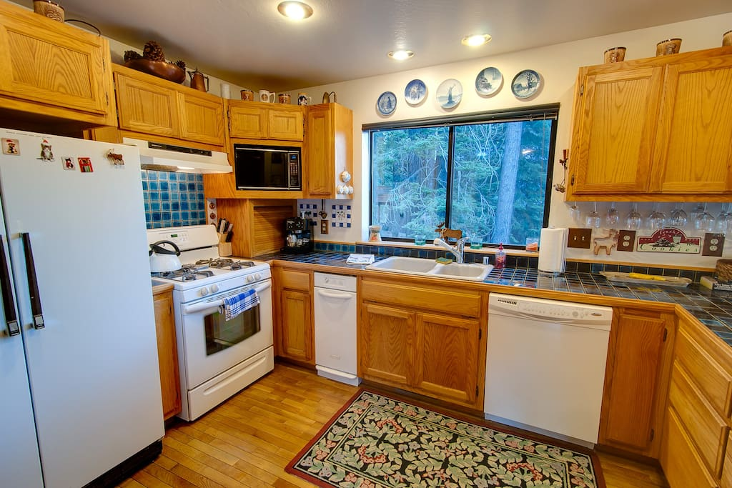 Full kitchen, pots, pans, and dishes