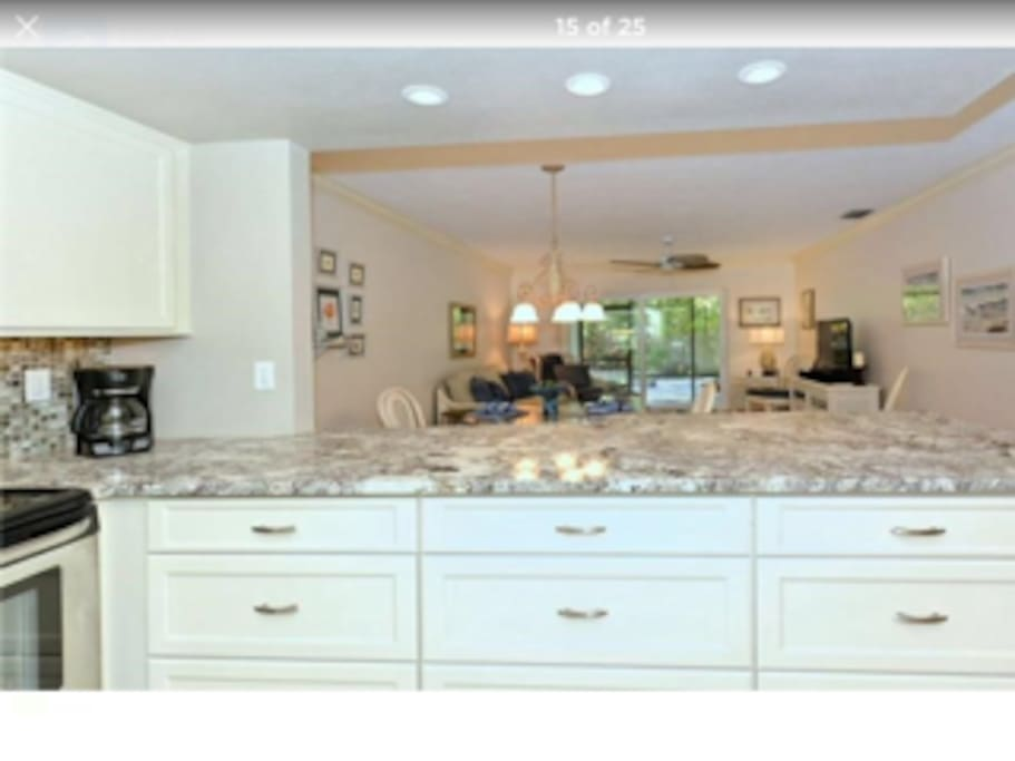 The kitchen area with full granite and stainless appliances and plenty of space.