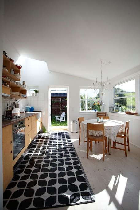 The kitchen with the finest light from the skylight and many windows incidentally in space