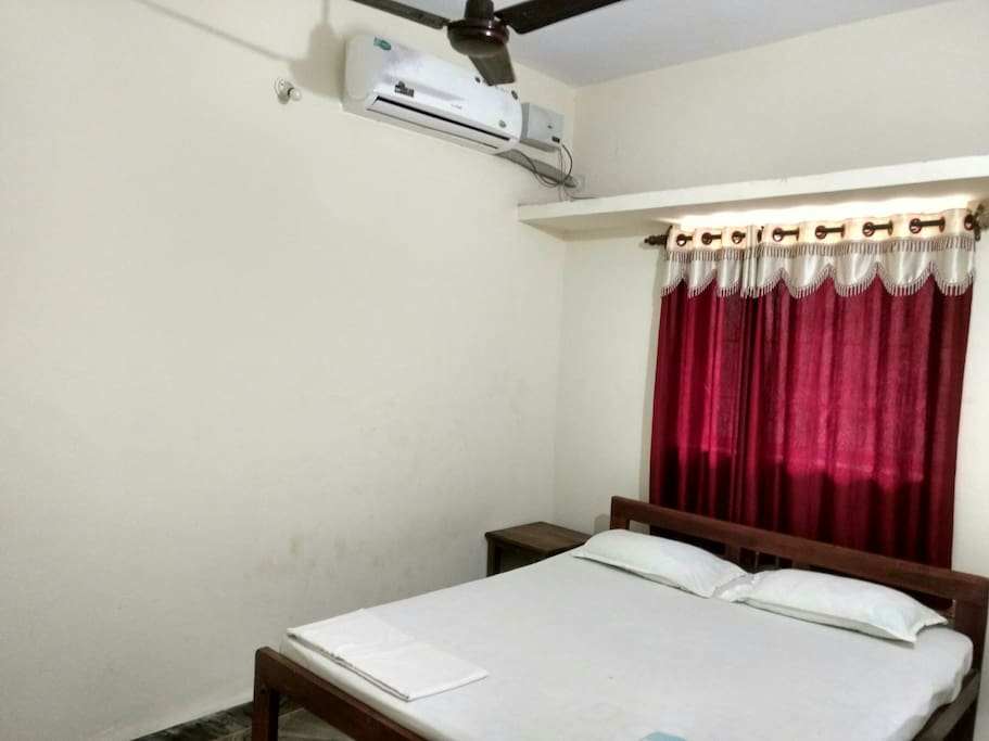 AC Bedroom with Double bed and bedside tables