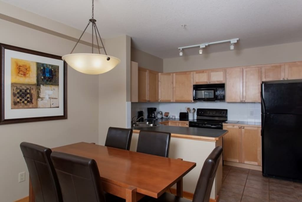 The dining area has seating for 5, where guests can enjoy meals together or entertain.