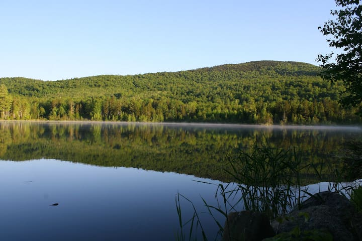 View of the pond from the beach, just in front of the cabin. This is Meadow Mountain, a southern shoulder of Puzzle Mountain.