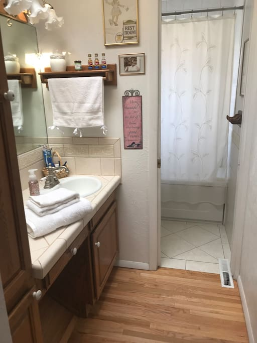 Full Private Bath with soaking tub and shower. Plenty of thick, cotton towels and other amenities.